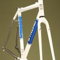 Custom Blend Titanium Cross Frame & Alpha QCX20 Fork. Custom White Powdercoat with Blue Panels.