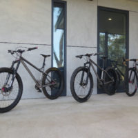 All three of his bikes. A titanium gravel road and two MTB's. One MTB is a double butted titanium 27.5″and the other is straight gauge 26″.