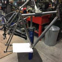 Custom Blend titanium gravel road with flat mount brakes. Tire clearance for 35mm.