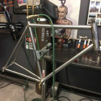 Titanium road bike designed for large tire clearance with long reach caliper brakes.
