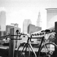 Custom aluminum frame with a flat black powder coat. Phil Wood hubs of course. Used it for messengering in Cleveland. It's got a ton of battle scars from over the years and still one of my favorite bikes.