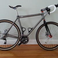 """Still frozen tundra in Connecticut. Waiting for maiden voyage, but looks absolutely sublime. I am sure you will be building more of these. I have named it """"Mango"""" in honor of the hub/head chris king color. 42 mm grand bois clinchers on Velocity rims and Chris King hubs. SRAM Red 10 speed group."""