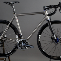 Custom Blend titanium road frame with Dura Ace Di2, Shimano hydraulic brakes and Enve/King wheels with Enve cockpit.