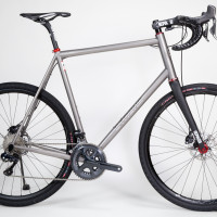 Titanium gravel bike fora  tall rider. Ultegra Di2, White Industries/Hed wheels, Enve fork and cockpit.
