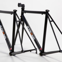 Here is a pair of identical Extralite steel road frames. They are True Temper S3 throughout. They also have a very nice looking semigloss finish.