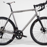 Custom Blend titanium gravel bikes with clearance for 44mm tires. Shimano Ult Di2, Reynolds wheels and Quarq crank.