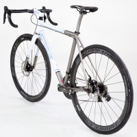 Titanium gravel bike with Sram eTap, Reynolds Attack and Black Magic paint.