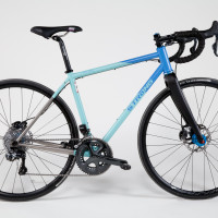 Titanium Di2 Disc road with large tire capacity.