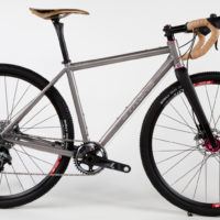 Titanium gravel bike with Sram Force 1 and flat mount brakes.