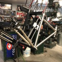Titanium gravel frame with flat-mount disc brakes. Ready for final finish and assembly.